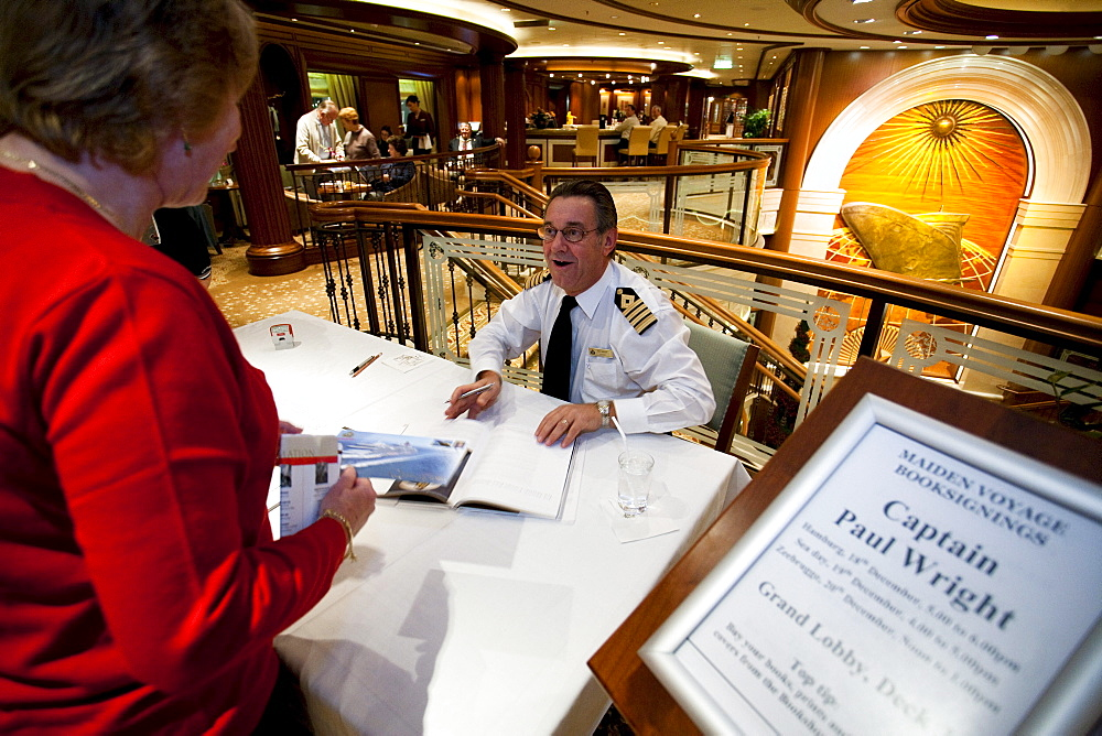 Book-signing with captain Paul Wright, Grand Lobby, cruise liner Queen Victoria
