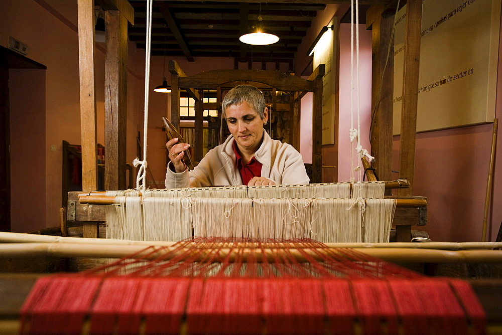Female silk weaver sitting at a hand loom, workshop, Las Hiladeras El Paso, El Paso, La Palma, Canary Islands, Spain, Europe