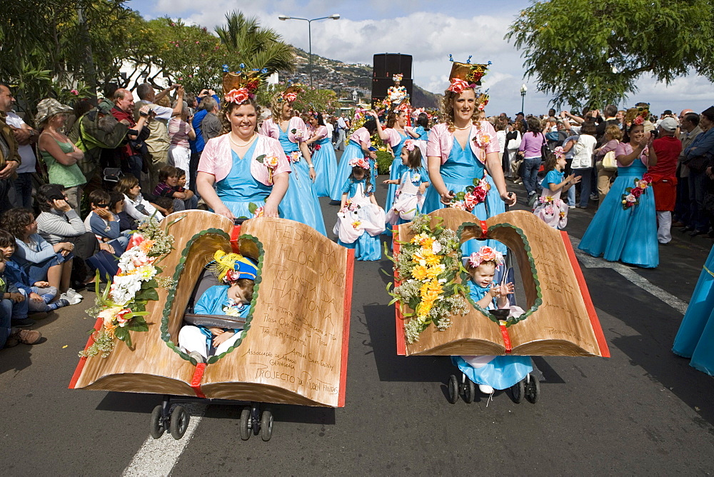 Mothers and children at the Madeira Flower Festival Parade, Funchal, Madeira, Portugal