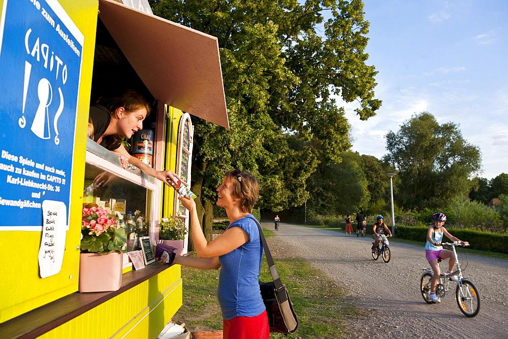 Customer at a kiosk, Leipzig, Saxony, Germany