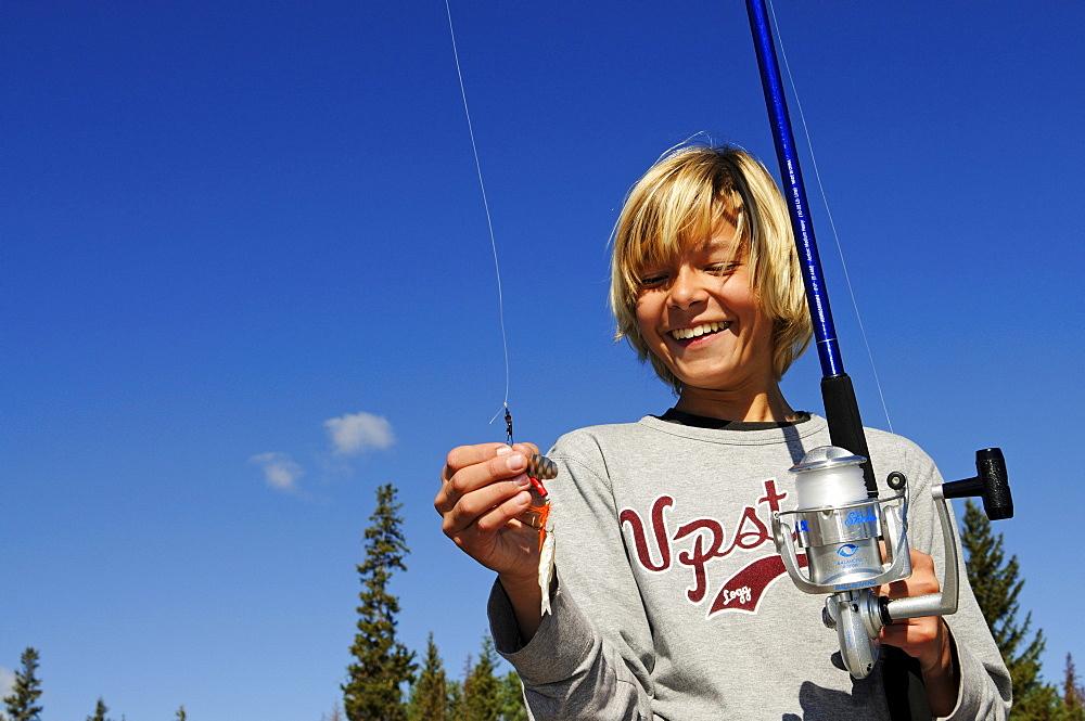 Fishing boy, British Columbia, Canada