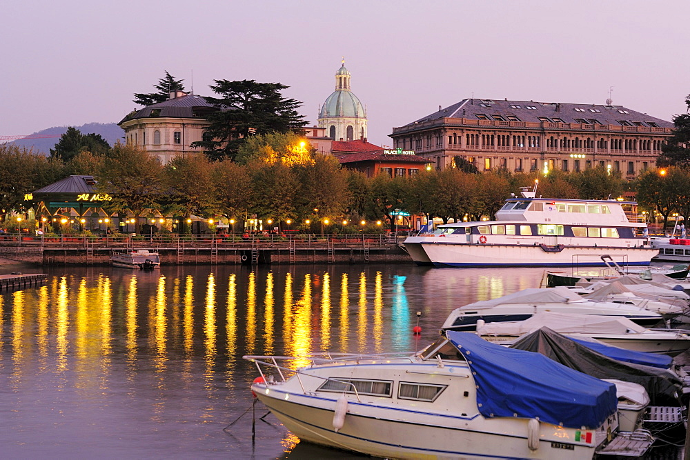 Boats in harbor of Lake Como, cathedral in background, Como, Lombardy, Italy