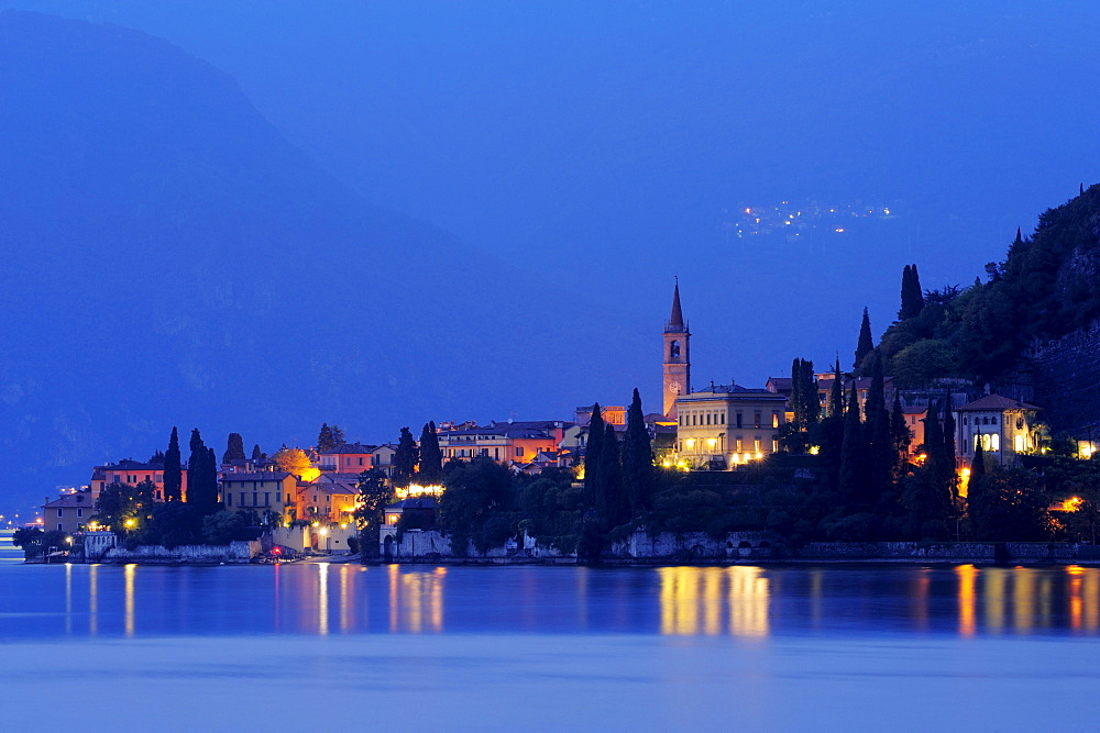 View over Lake Como to Varenna at night, Lombardy, Italy