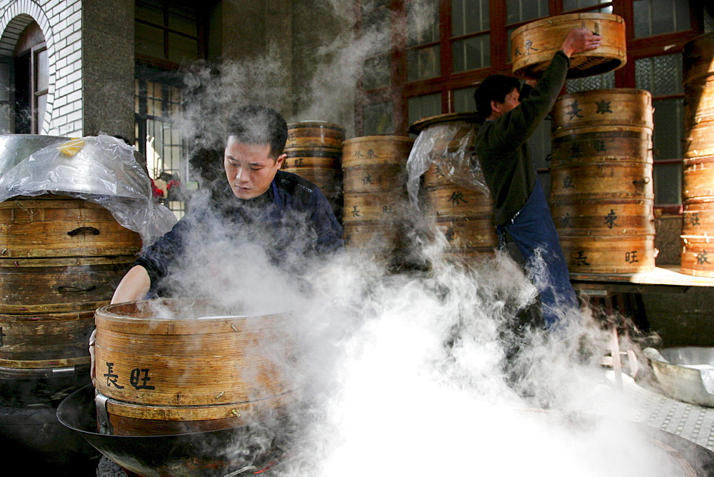 Man with steaming bamboo baskets, Jinfeng, Changle, Fujian province, China, Asia