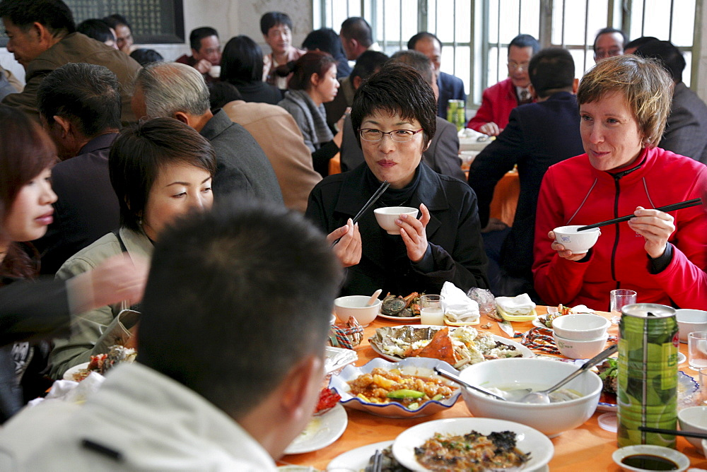 German, Japanese and Chinese guests at a restaurant at a traditional chinese wedding, Jinfeng, Changle, Fujian province, China, Asia