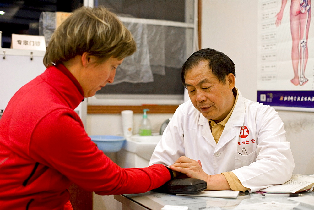 Chinese doctor examining german patient, Xiamen, Fujian, China, Asia