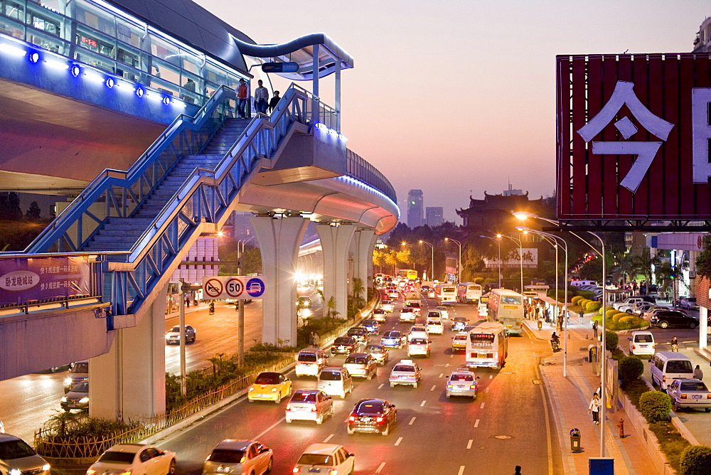 Cars and pedestrians on the street in the evening, Lianqian West Road, Huli District, Xiamen, Fujian, China, Asia