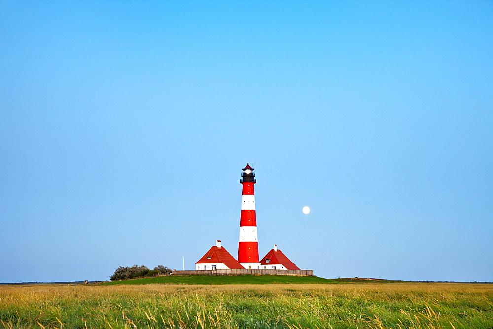 Westerheversand Lighthouse with full moon, Westerhever, Schleswig-Holstein, Germany