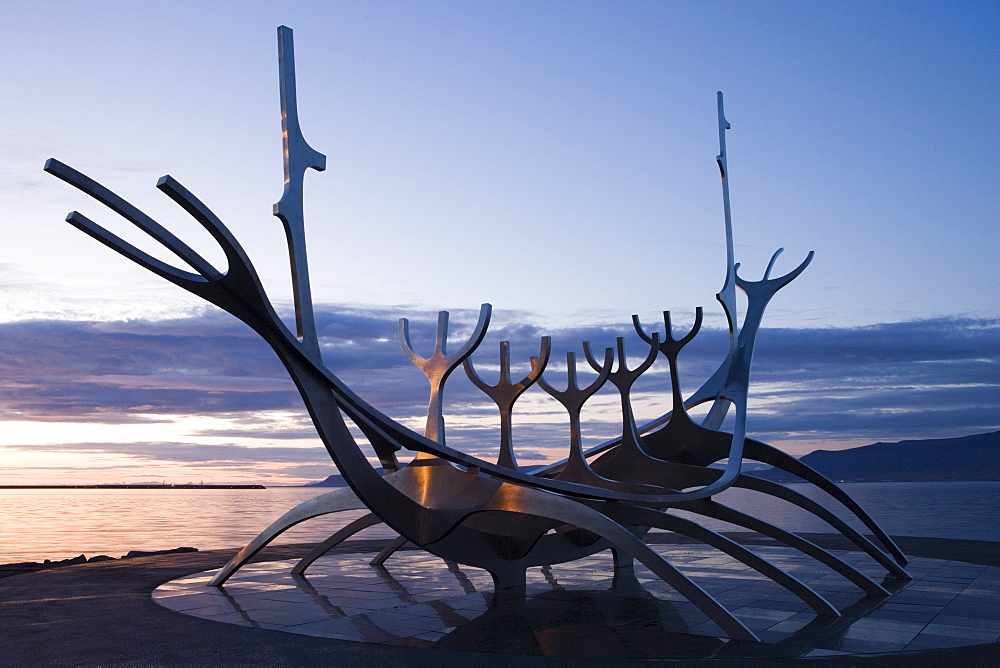 Sculpture of a viking ship on the waterfront in the evening, Reykjavik, Iceland, Europe