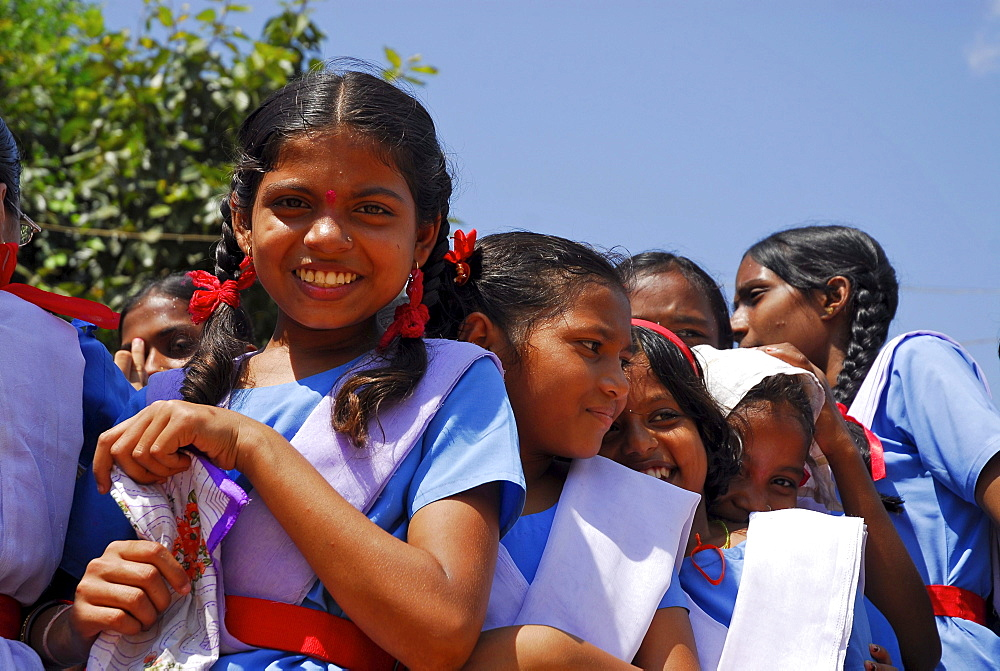 Girls wearing school uniforms in the sunlight, Bastar, Chhattisgarh, India, Asia