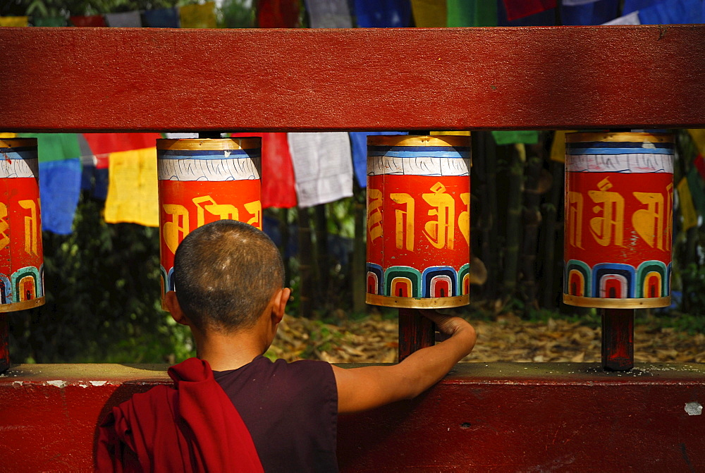 Novice with prayer wheel, Enchey monastery, Sikkim, Himalaya, Northern India, Asia