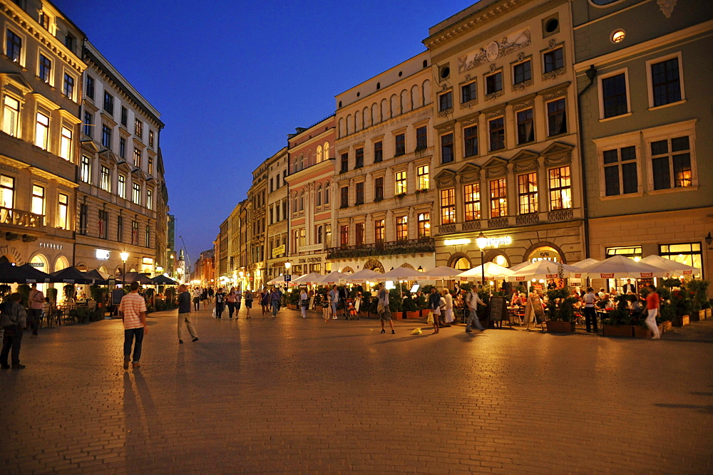 Rynek glowny, market place with street cafes in the evening, Krakow, Poland, Europe