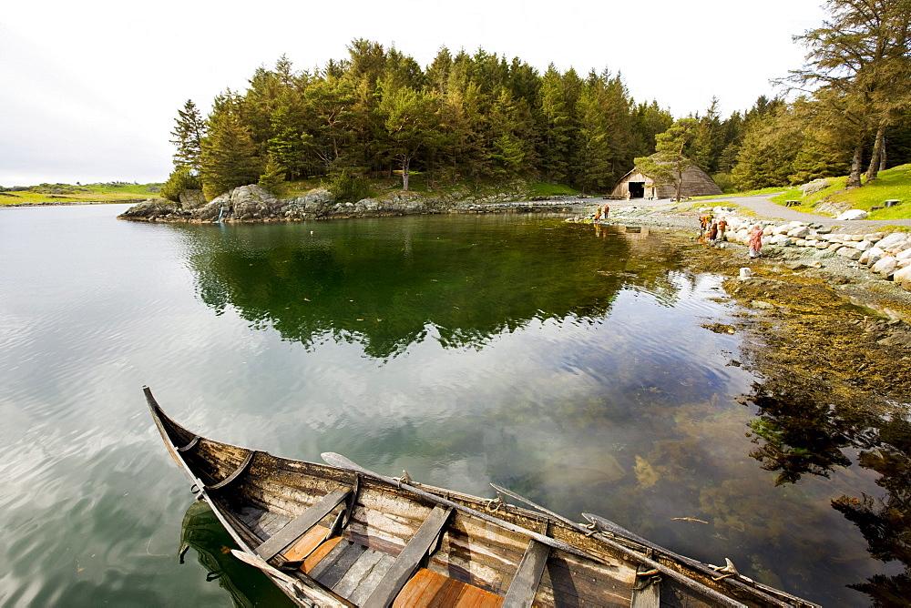 Viking rowing boat and viking house at a lake, Bukkoy, Avaldsnes, Haugasund Rogaland, Norway, Scandinavia, Europe