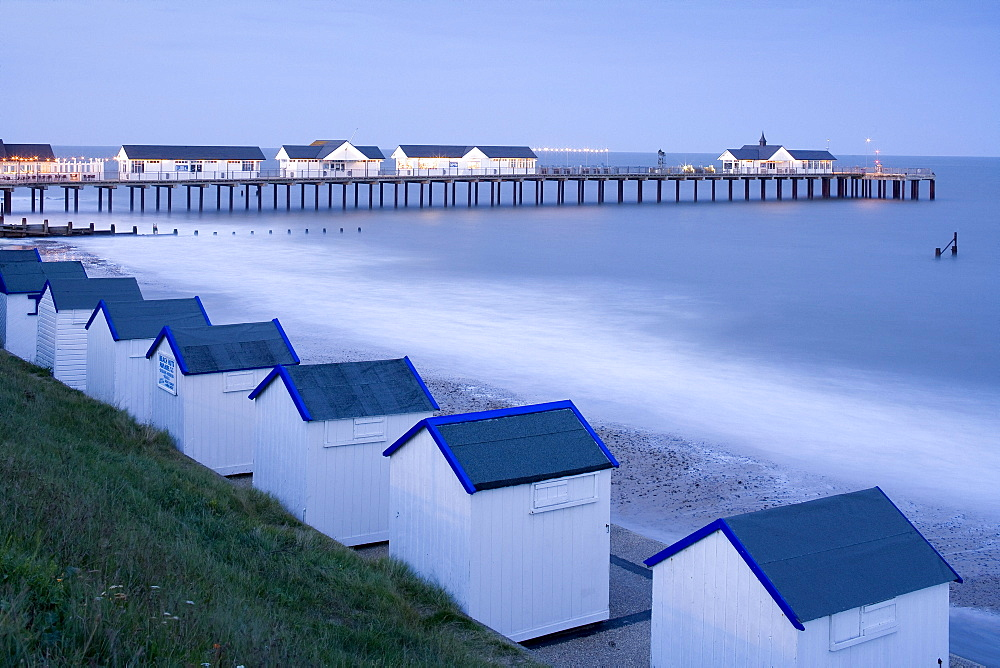 Beach huts and Pier in Southwold, East Anglia, Suffolk, England, Great Britain, Europe