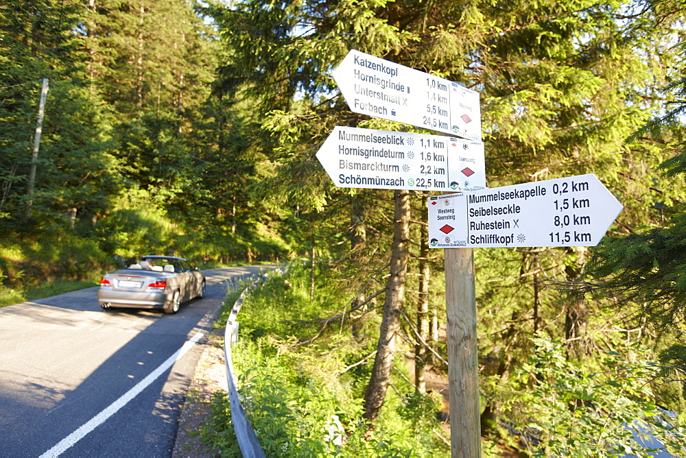 Convertible passing road near Lake Mummelsee, Seebach, Black Forest, Baden-Wuerttemberg, Germany