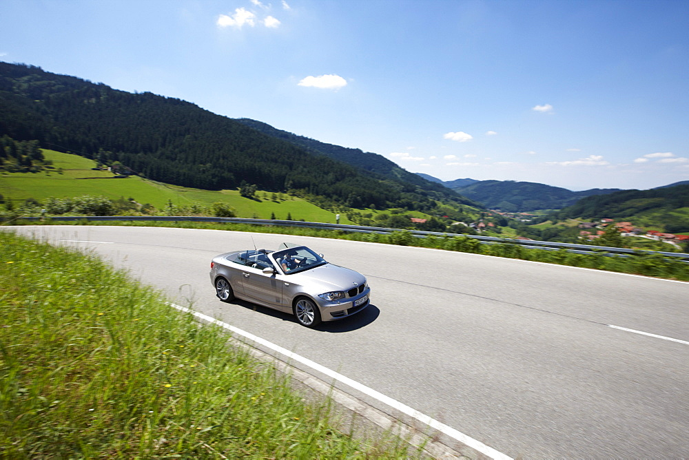 Convertible on street, Black Forest, Baden-Wuerttemberg, Germany