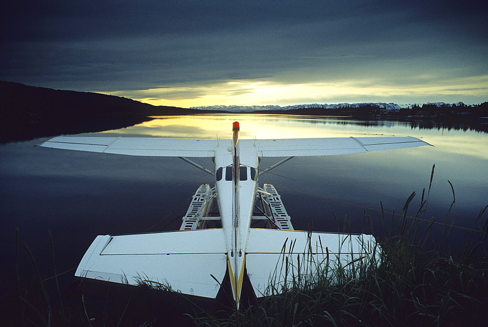 Floatplane at Beluga Lake under dark clouds, Kenai peninsula, Alaska, USA, United States of America