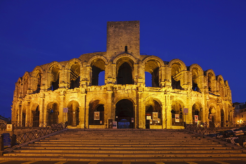 The illuminated amphitheatre in the evening, Arles, Bouches-du-Rhone, Provence, France