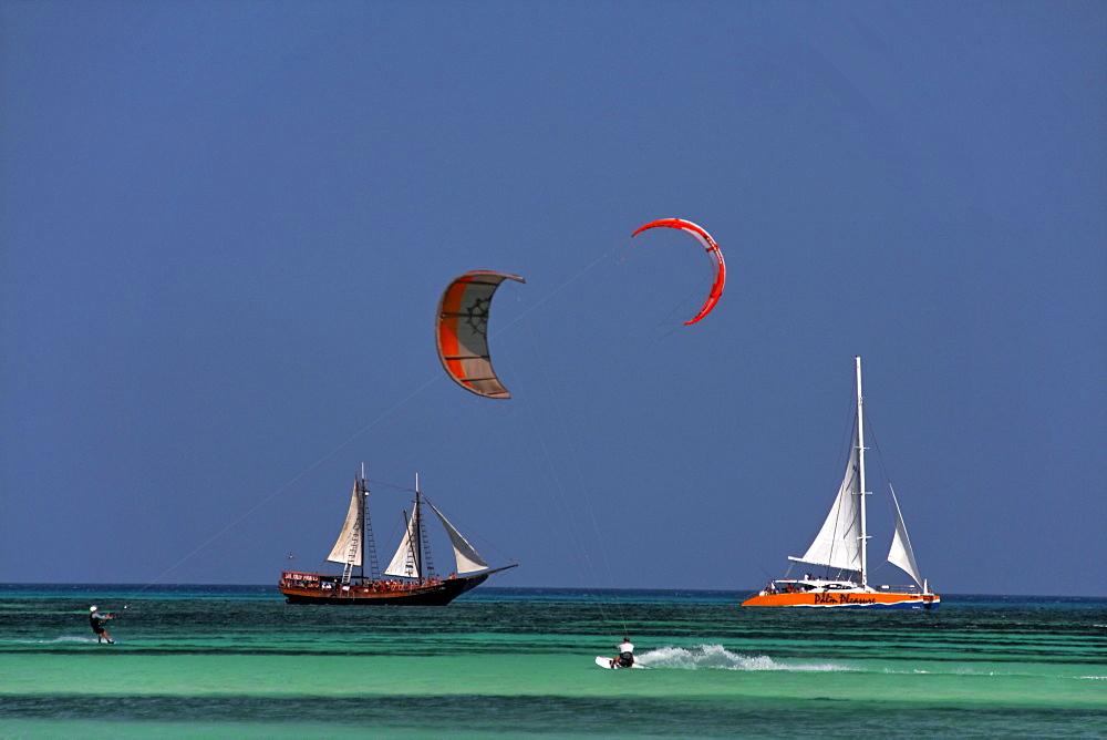 West Indies, Aruba, Kite Surfer, Thre Master sailing boat, Palm Pleasure catameran