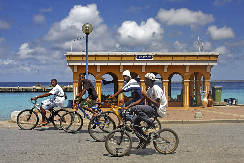 West Indies, Bonaire, Kralendijk, local kids with bicycles, Promenade