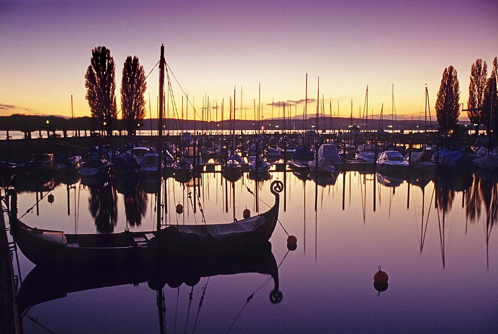Viking ship at the marina at dusk, Unteruhldingen, Lake Constance, Baden Wurttemberg, Germany