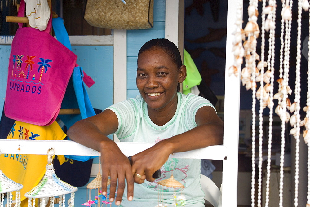 Saleswoman in a souvenir shop at North Point, Barbados, Caribbean