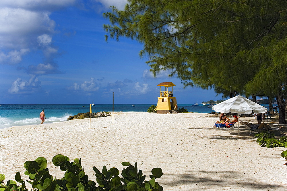 People sunbathing at Miami Beach, Oistins, Barbados, Caribbean