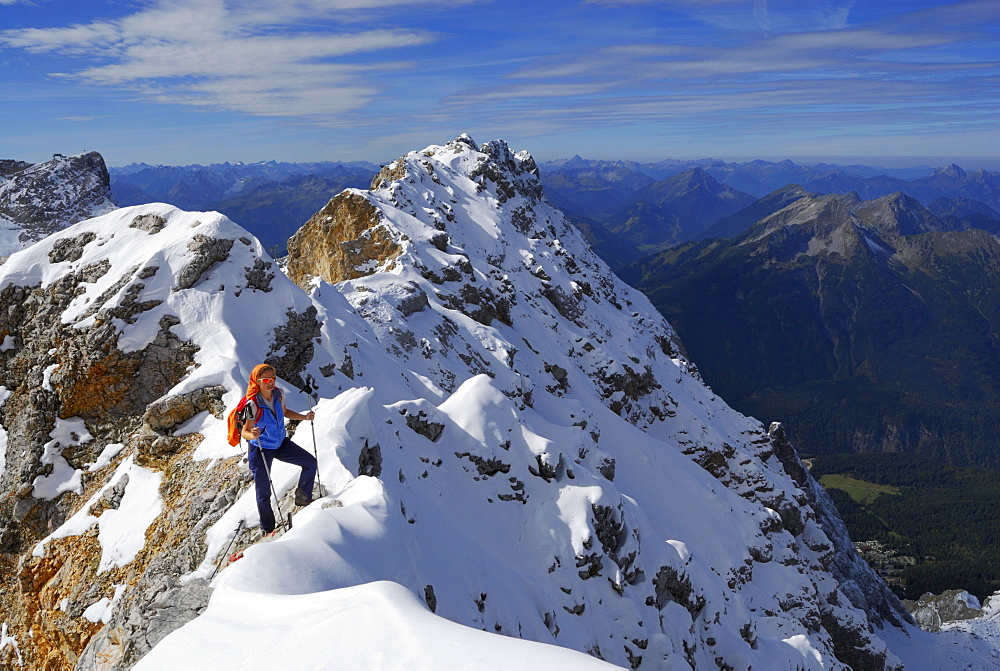 Woman on ridge to summit of Zugspitze, Wetterstein range, Upper Bavaria, Bavaria, Germany