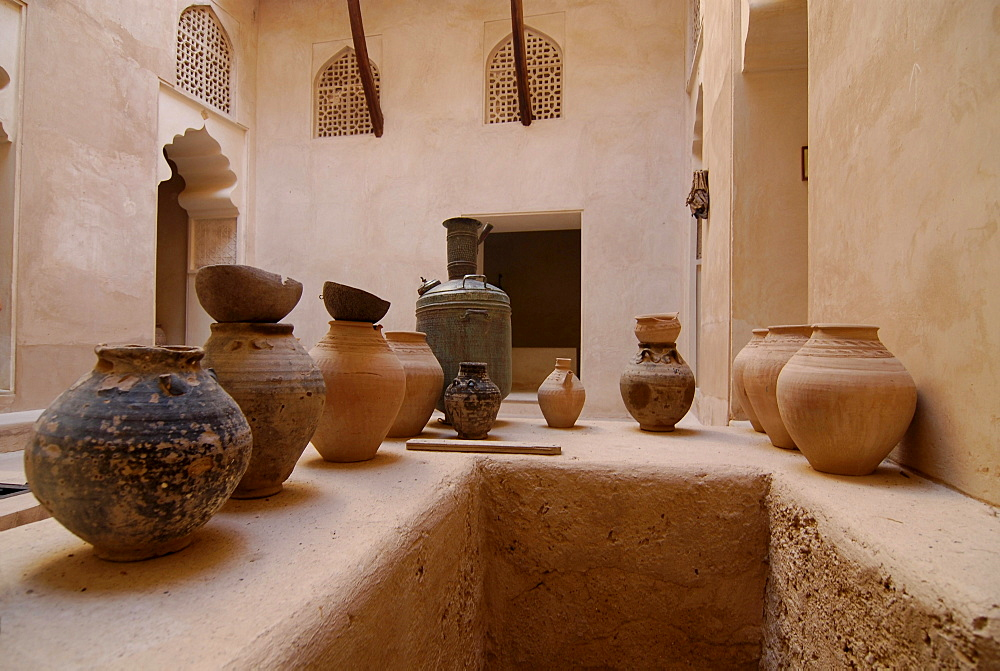 Stoneware jugs at the deserted courtyard of Fort Jabrin, Oman, Asia