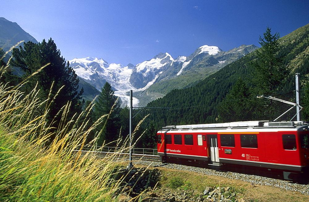 Red Train of Rhaetische Bahn in front of mountain range of Bellavista, Piz Argient, Crast Aguezza, Piz Bernina, Piz Prievlus and Piz Morteratsch, Ferrovia Raetia, Bernina range, Bernina, Morteratsch, Oberengadin, Engadin, Grisons, Switzerland