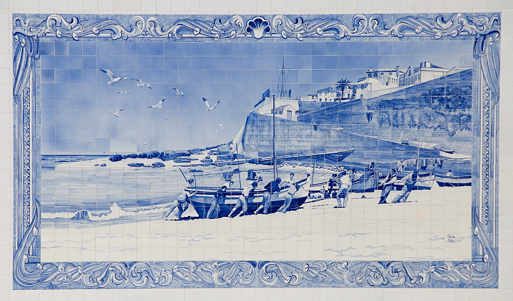 Painted tile of fishermen pulling a boat onto the beach, harbour, Ericeira, Portugal