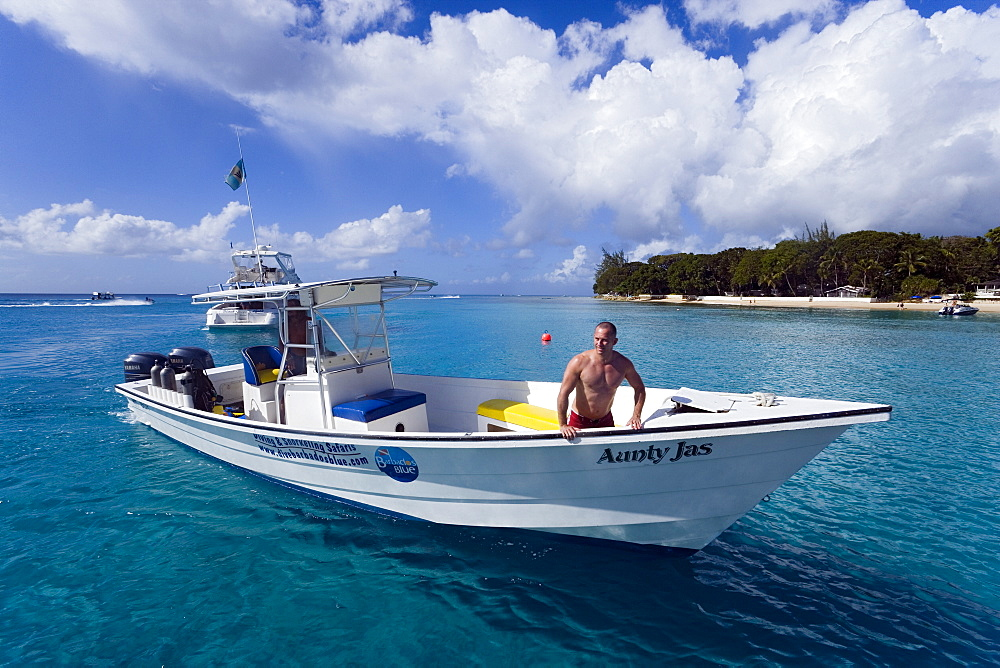 Man in a motorboat, Sandy Lane Bay, Barbados, Caribbean