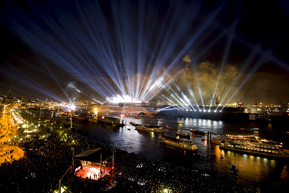 Great lightshow above the ships on the river, Hamburg, Germany