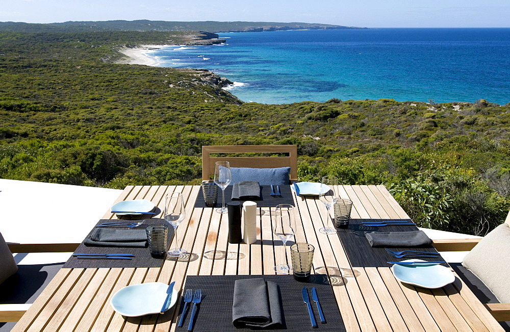 A table is laid on the terrace of the Southern Ocean Lodge with view at Hanson Bay, Kangaroo Island, South Australia, Australia