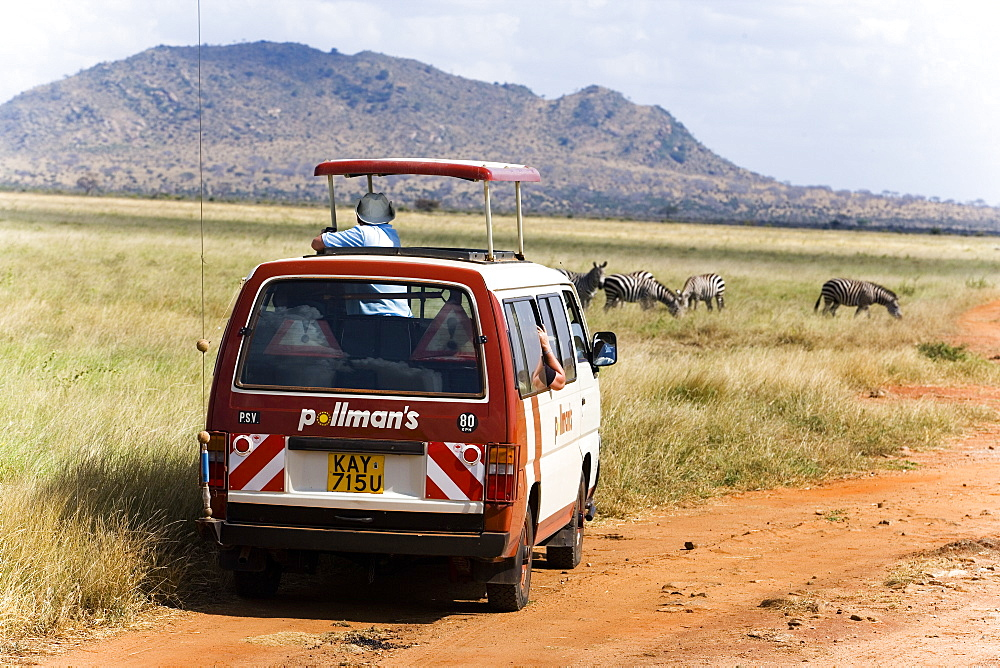 Safari bus on the way in Tsavo East National Park, Coast, Kenya