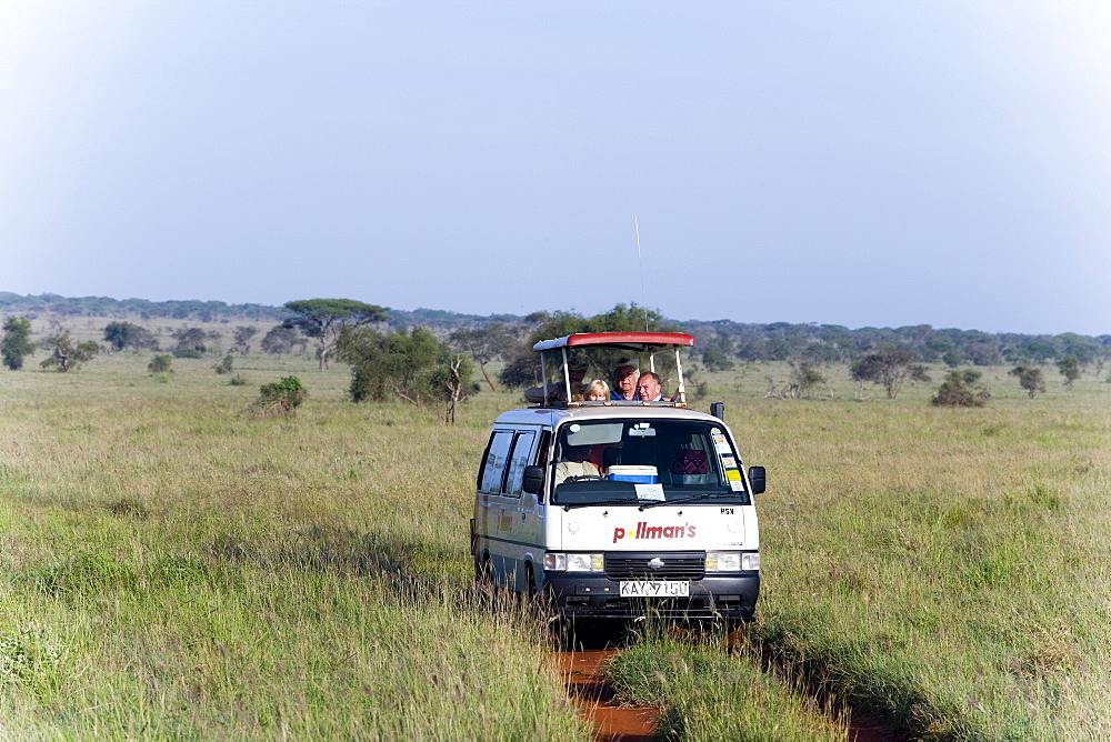 Safari bus on the way in Taita Hills Game Reserve, Coast, Kenya