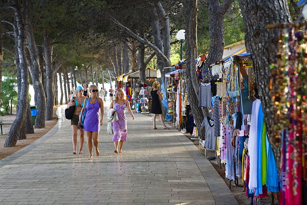 Tourists and sales stalls at the promenade, Bol, Brac Island, Dalmatia, Croatia, Europe
