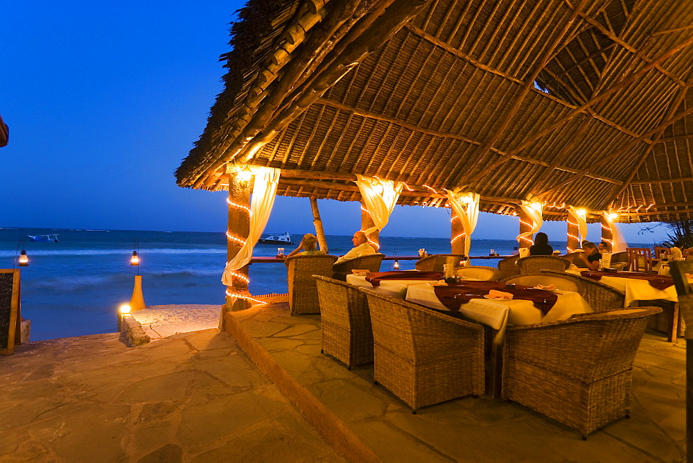 Couple sitting in a beach bar, The Sands, at Nomad, Diani Beach, Kenya