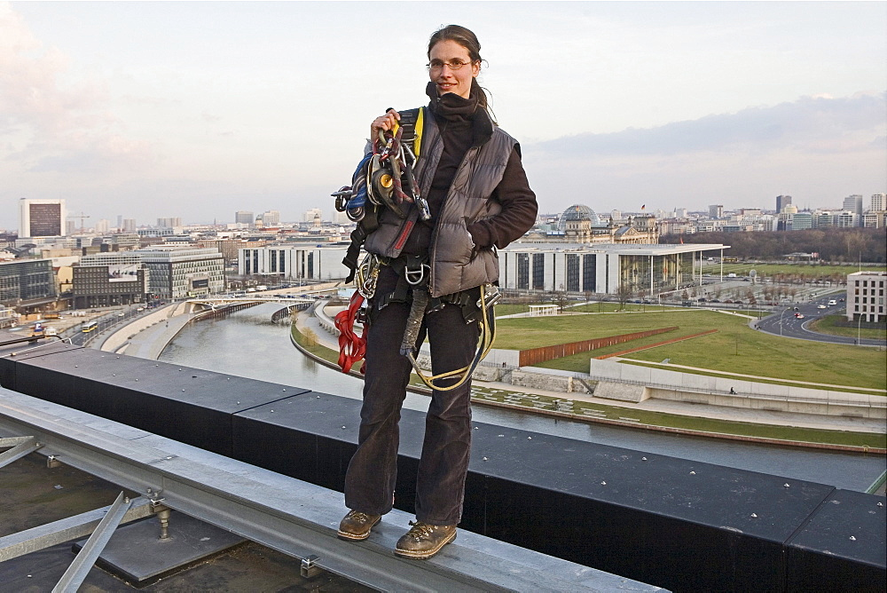 woman roof worker with equipment on central railway station, Berlin