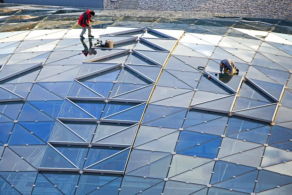 repairing glass roof, Potsdam Platz, Berlin Germany
