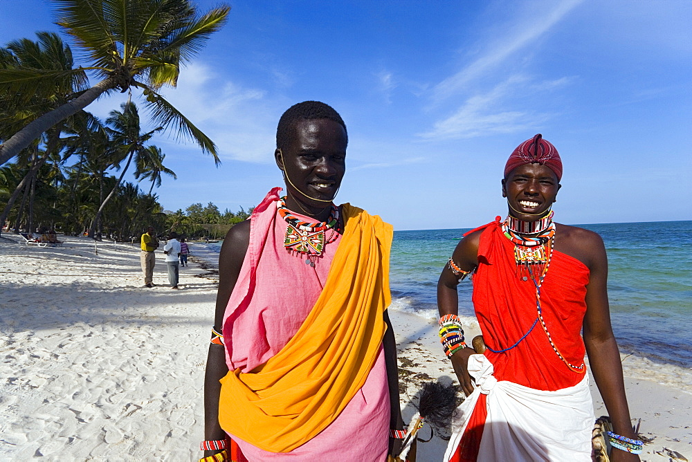 Two Massai wearing traditional clothing at Shanzu Beach, Coast, Kenya