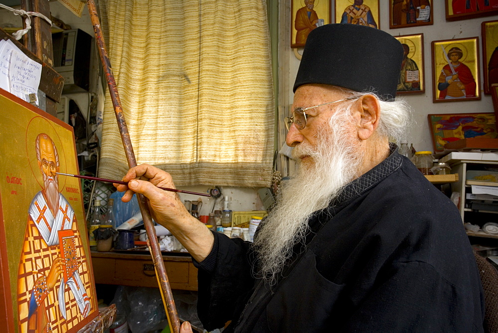 Icon painter Father Kallinikos painting an icon, Stravrovouni monastery, Larnaka, South Cprus, Cyprus