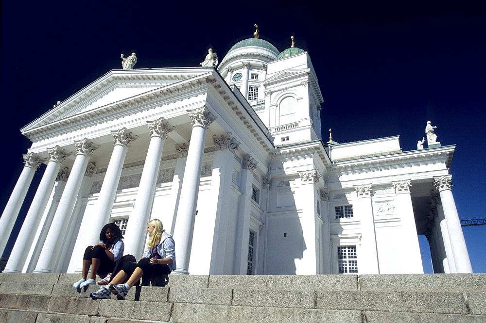 People sitting on the stairs in front of the cathedral, Helsinki, Finland, Europe