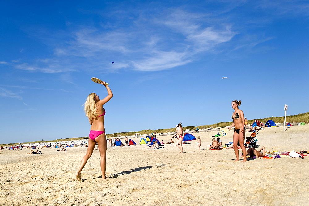 Women playing beach tennis, Westerland, Sylt Island, Schleswig-Holstein, Germany