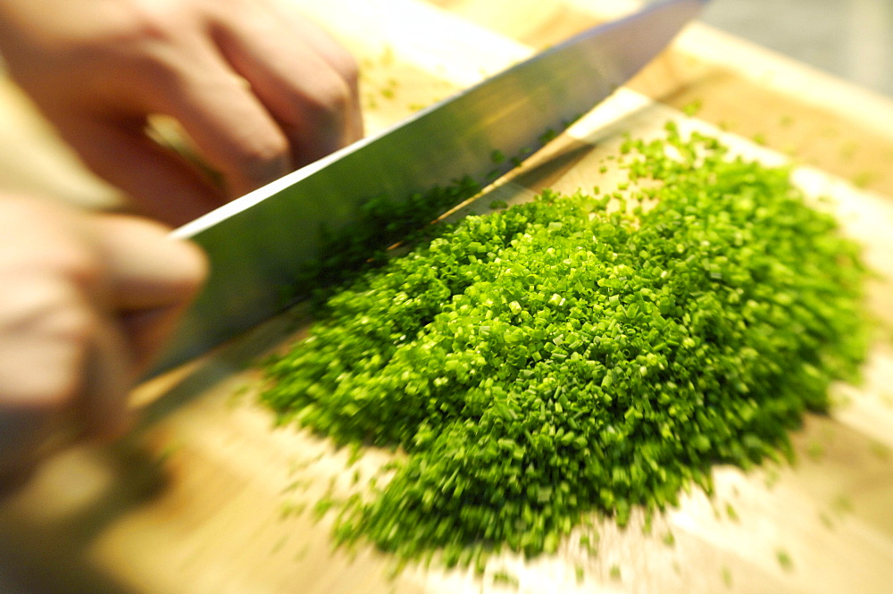 Minced chives and a knife on a cutting board, Restaurant Steinbock, Villanders, Valle Isarco, South Tyrol, Italy, Europe