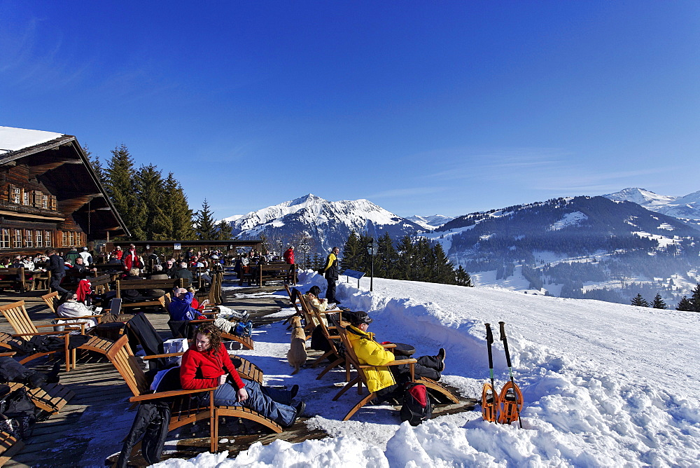 People resting on terrace of a mountain restaurant, Eggli, Gstaad, Bernese Oberland, Canton of Berne, Switzerland