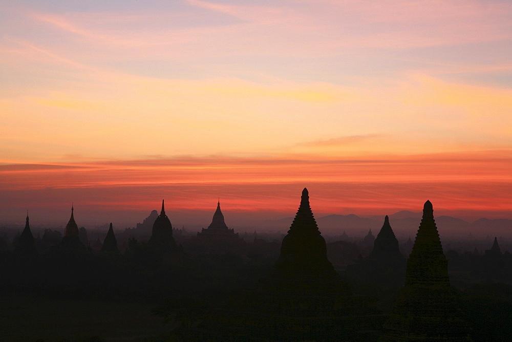 Sunrise over temple towers at the plain of Bagan, Myanmar, Burma, Asia
