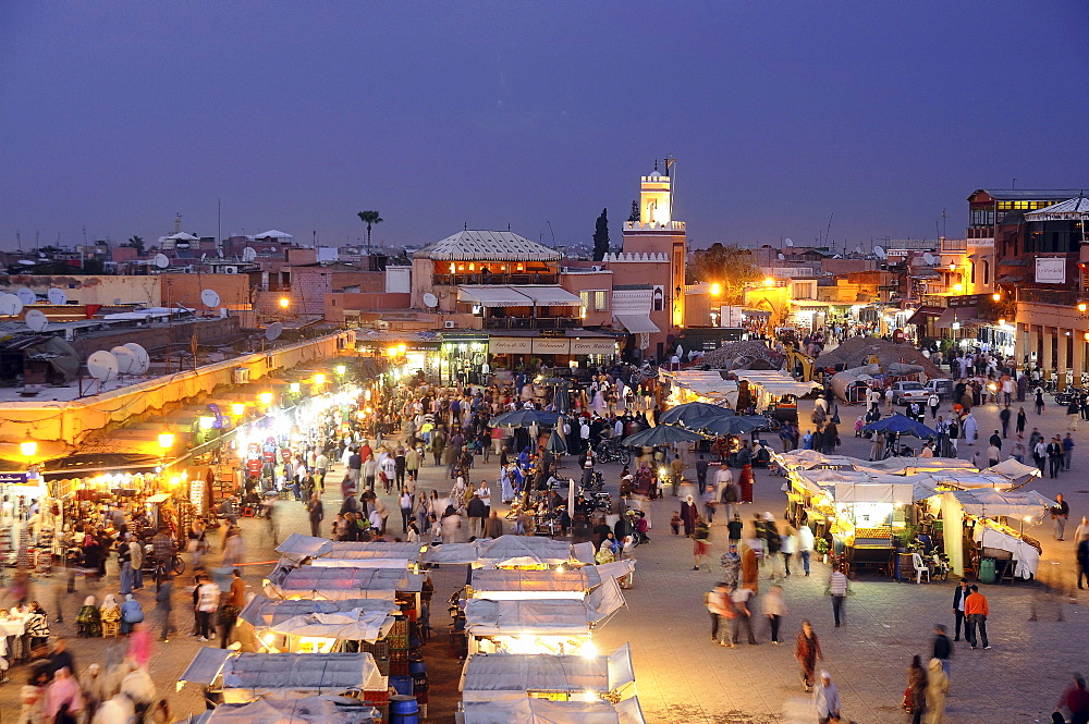 Illuminated snack stalls at the Place Jemaa el-Fna in the evening, Marrakesh, South Morocco, Morocco, Africa