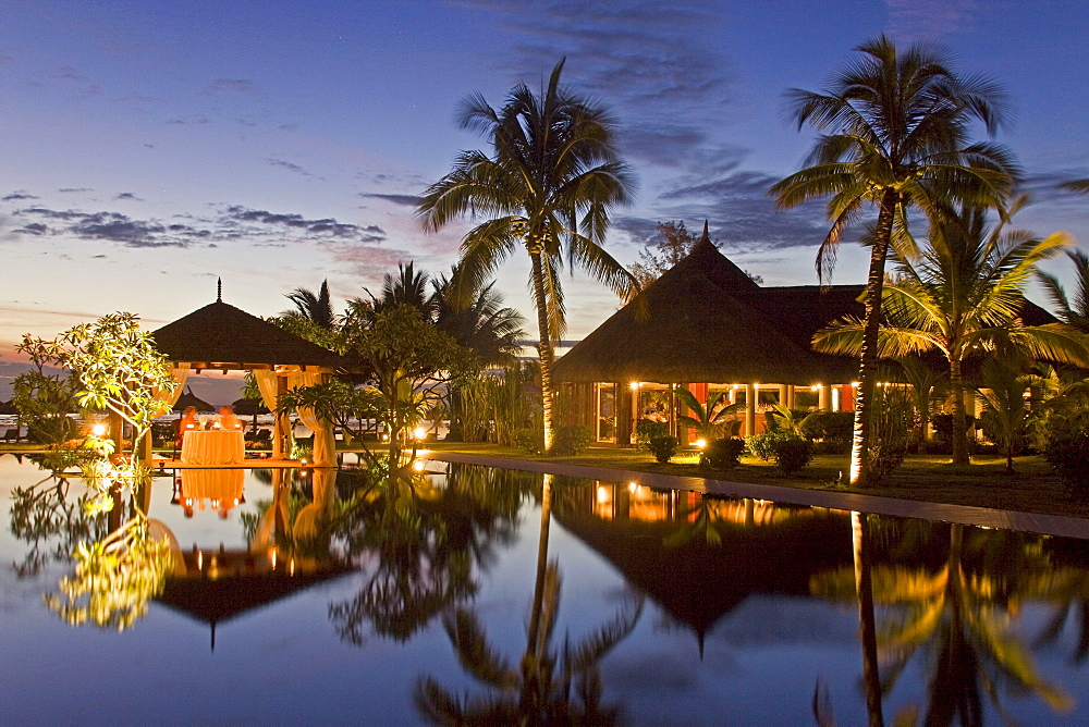 Resort Moevenpick at twilight, luxery table in small pavillion, sunset, south coast of Mauritius, Africa