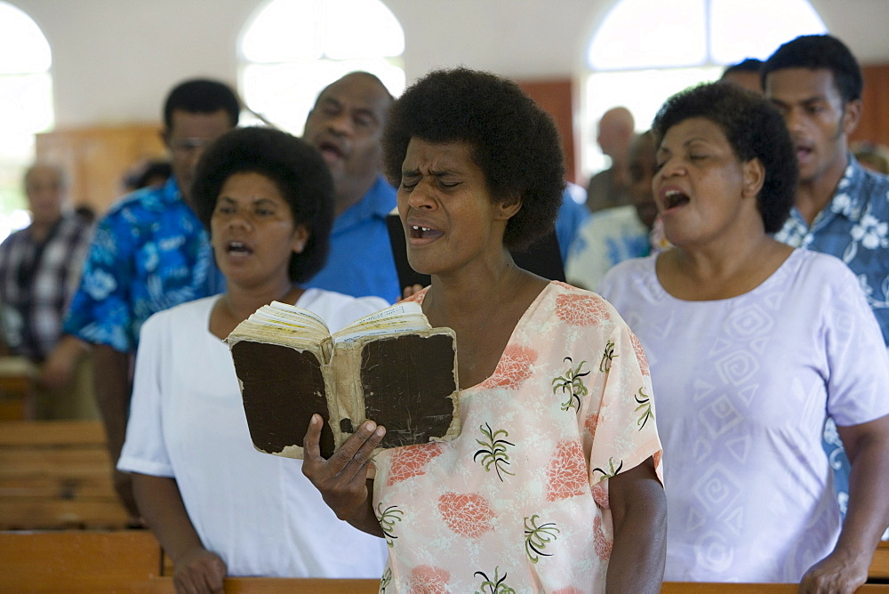 People singing at church service at the village Naidi, Vanua Levu, Fiji Islands, South Pacific, Oceania